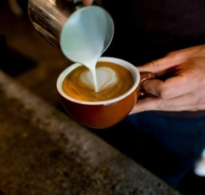 person pouring a coffee