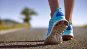 runner walking on road