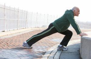 an elderly man stretching