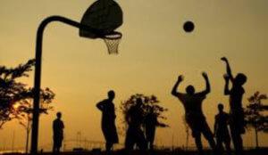 people playing basketball outside
