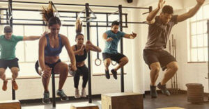 people jumping in a group exercise class