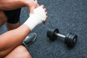 a person with an injured hand at gym