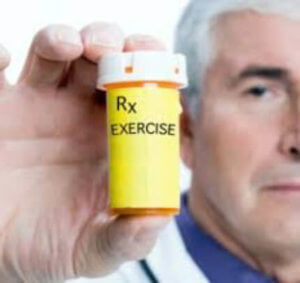 doctor holding pill box with exercise prescribed
