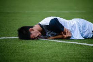 concussed soccer player on ground