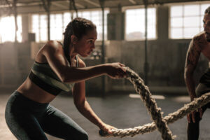 woman with ropes at gym